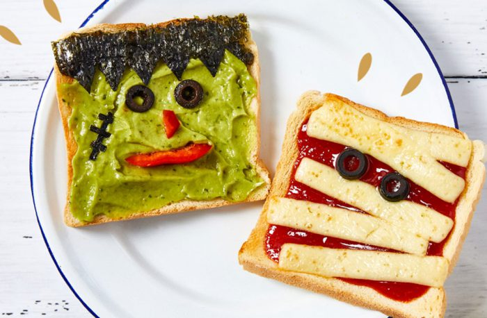 Slices of toast decorated to look like Halloween monster and mummy on a plate