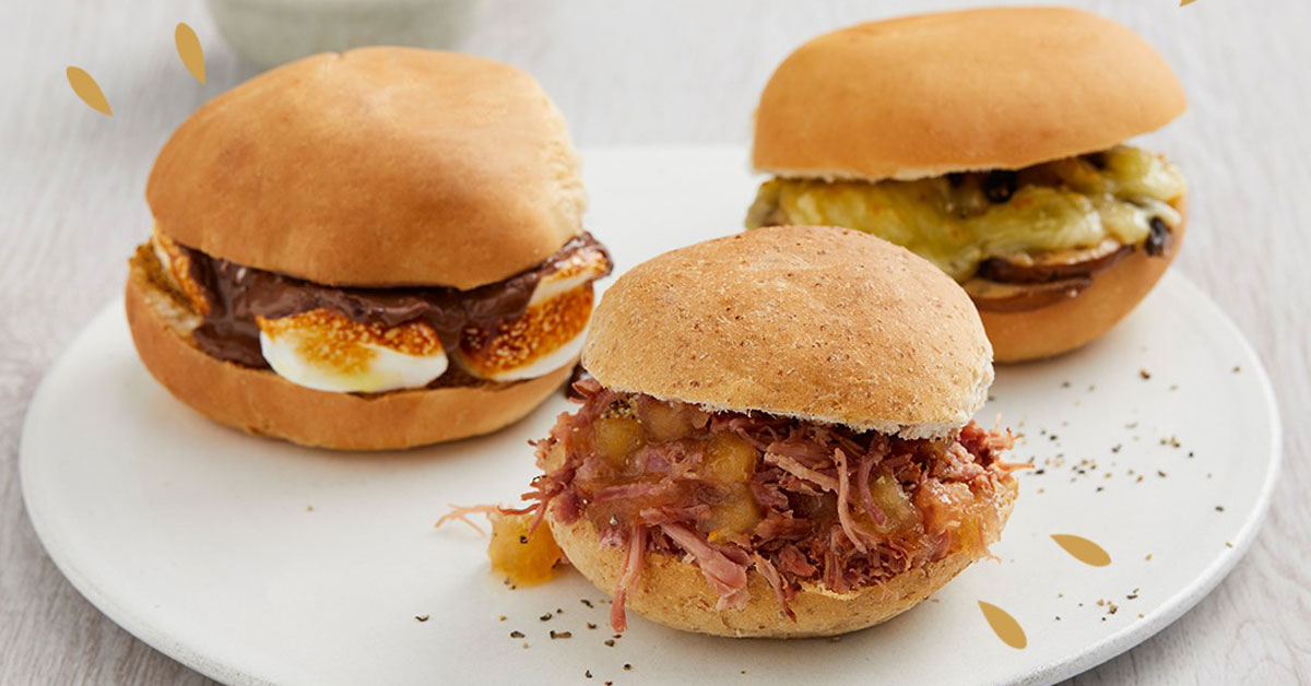 A plate of three Bonfire Night savoury and sweet burgers on a white table